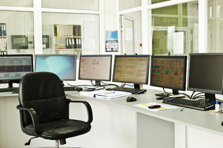 flat panel monitor: Control center of a small power plant Stock Photo