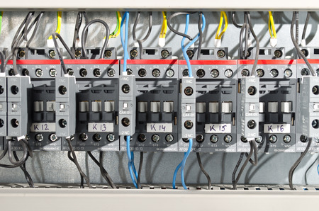 Electrical panel at a assembly line factory. Controls and switches Archivio Fotografico