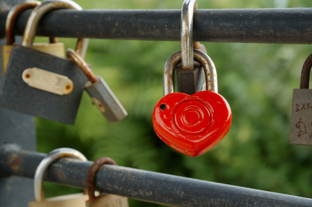 fastened: Rusty padlocks hang on sling love forever concept Stock Photo