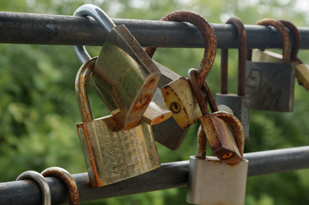Rusty padlocks hang on sling love forever concept Stock Photo