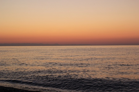 Fine dawn with a sea smooth surface
