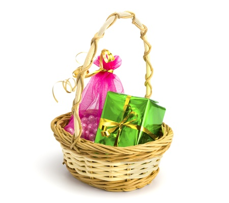 Basket with gifts on the white isolated background photo