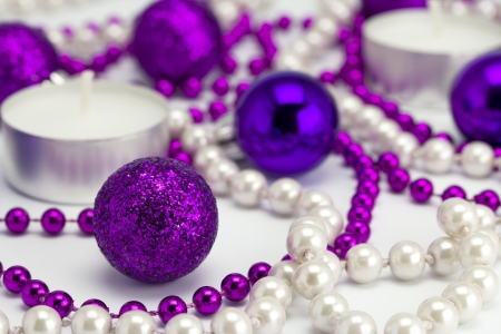 New Year s background from toys and a beads on a white background