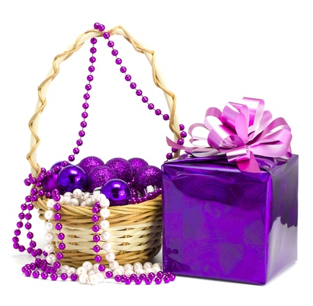 Gift and toys in a basket on the white isolated background photo