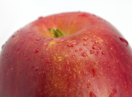 Apple with droplets close up on the isolated white background Stock Photo