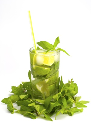 Alcoholic drink of Mojito and mint on a white background