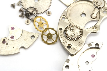 escapement: Clockwork details on the white isolated background Stock Photo