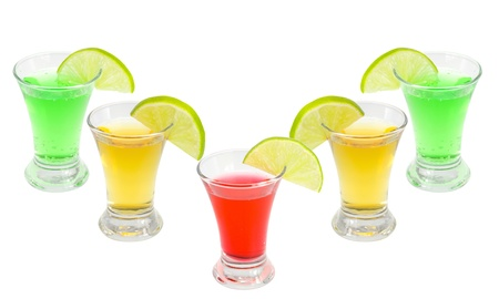 Cocktails alcoholic with a lime on the white isolated background