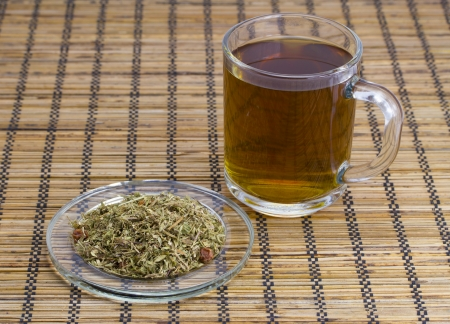 water thyme: Tea on herbs on a wooden background
