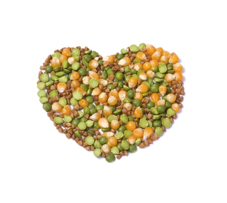 Peas, corn and buckwheat isolated on white background photo