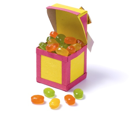 Handmade paper box with candy isolated on white background