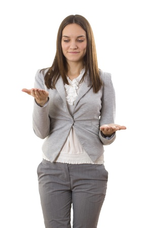 Business lady compares. White isolated background Stock Photo
