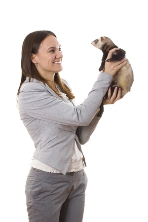 Lady holding a ferret. White isolated background photo