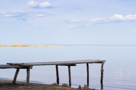 Beach with wooden bridge on the sea photo