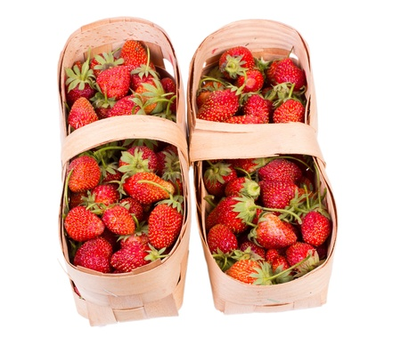 Strawberries in a basket isolated on a white background photo