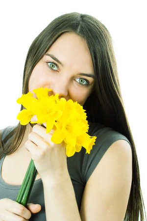 The girl with yellow narcissuses photo