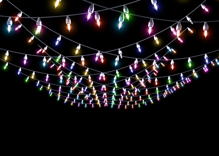Multicolored glowing garland on black isolated background photo
