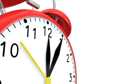 show time: Red alarm clock on isolated background show time 12:05