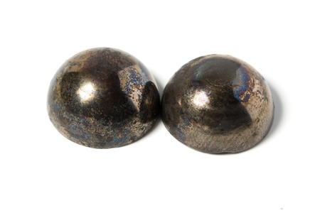 half ball: The bursting of the half ball bearing. Because of the poor quality of the bearing, there was a strong overheating, destruction of the separator and split in half ball bearings. Isolated background