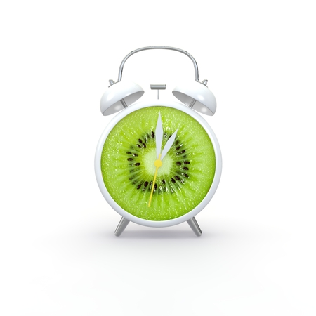 Kiwi slice alarm clock on white background. Minimal business concept.