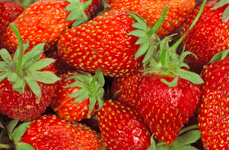 The texture of ripe strawberries