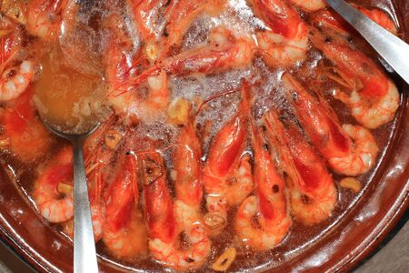 Fried shrimp in olive oil with garlic in a restaurant in Spain