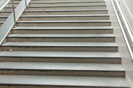 Stairs from the underpass with railings goes up Stock Photo