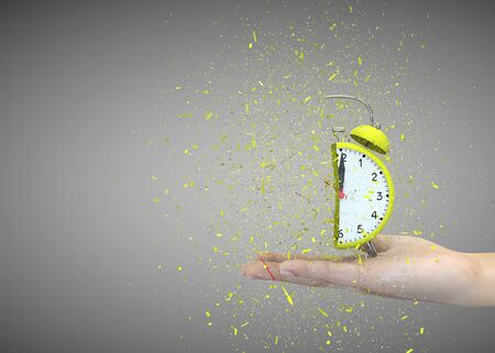 Alarm clock yellow on a gray background explodes in the girls hands. 3D illustration