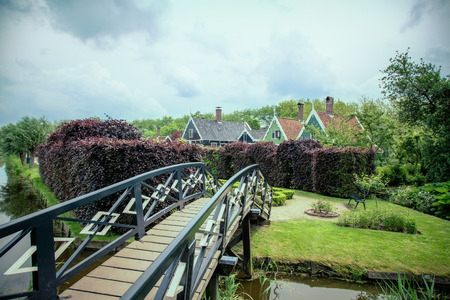 old wooden bridge over the River to the House photo