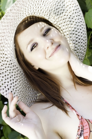 sun hat: Beautiful smiling girl with sun hat  added grain