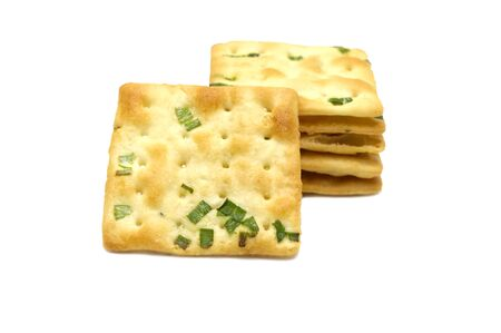 Biscuits cracker square design.Great flavor combination of green onion and wheat. Isolated on white background.