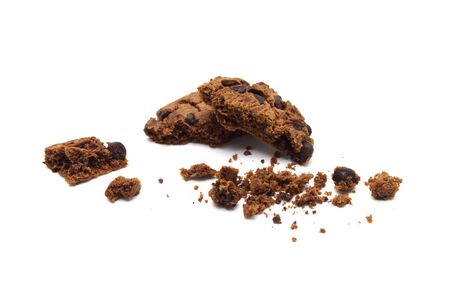 Chocolate chip cookies with some broken and crumbs isolated on white background. Stock Photo