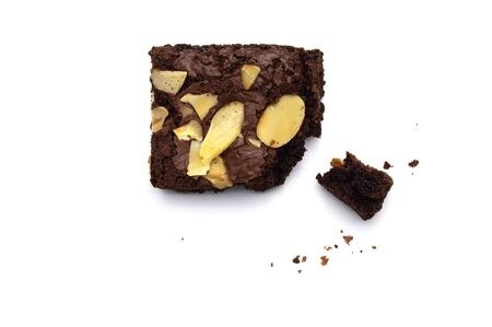 Chocolate brownie with sliced almond nuts toppings crumbs isolated on white background.