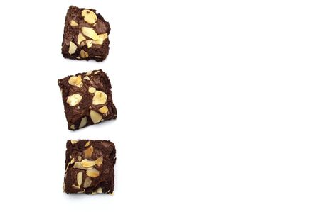 Chocolate brownies with sliced almond nuts toppings isolated on white background and copy space.
