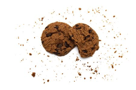 Chocolate chip cookies and crumbs on white background and Top view. Stock Photo