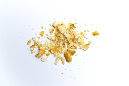 Crumbs of cookies on white background.