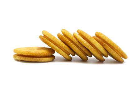 Biscuit sandwich cracker Cheese flavoured ,Cream and butter. Stack of crunchy delicious sweet meal and useful cookies. Isolated on white background.