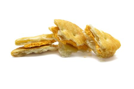 Biscuit and crumbs of sandwich cracker Cheese flavoured ,Cream and butter. Crunchy delicious sweet meal and useful cookies. Isolated on white background.