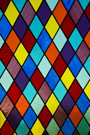 colored window: Stained glass with multi colored diamond pattern
