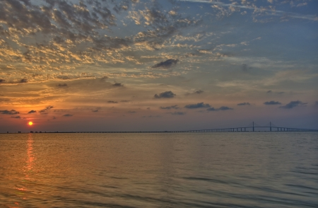 Sunrise over Tampa Bay and the Sunshine Skyway Bridge photo