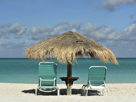 getting away from it all: Two chairs and umbrella on a tropical beach Stock Photo