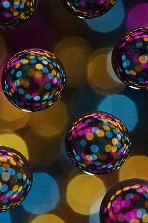 Multi colored balls against defocused light background