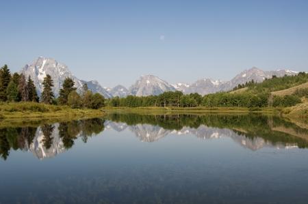 Teton Mountains reflecting in water, Grand Teton National Park Stock Photo