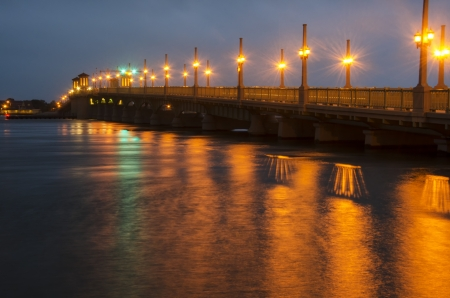 augustine: Bridge of Lions in St. Augustine, Florida at night reflecting in water Stock Photo