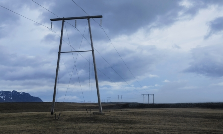 Power lines stretching across beautiful country side in Iceland