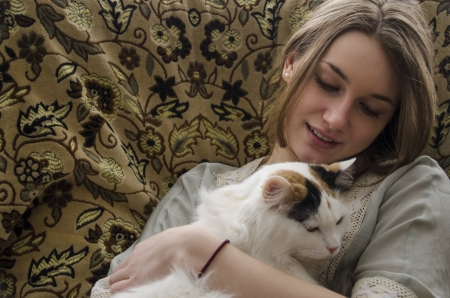 Pretty young woman holding a cat