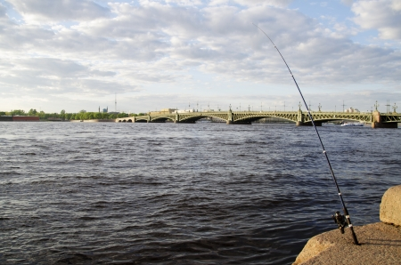 View of the Trinity Bridge over River Neva in St  Petersburg, Russia with a finishing rod in the foreground