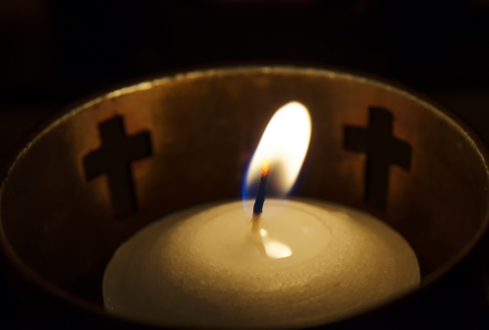 Close up of a burning prayer candle