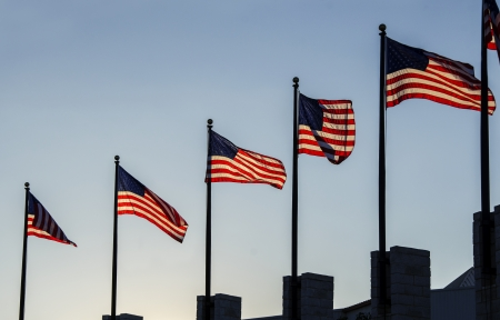 Six American flags waving in the wind Stock Photo