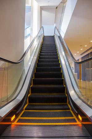 Empty escalator in a commercial building Banco de Imagens